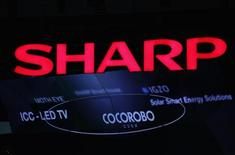 A logo of Sharp Corp is pictured at CEATEC JAPAN 2012 electronics show in Chiba, east of Tokyo, October 2, 2012.Japan's largest cutting-edge IT and electronics trade show started on Tuesday and runs until October 6 at Makuhari Messe convention center. REUTERS/Yuriko Nakao (JAPAN - Tags: BUSINESS LOGO)