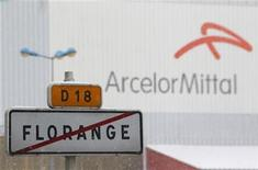 A road sign with the crossed out city name of Florange is seen in front of the ArcelorMittal plant in Florange, Eastern France, December 3, 2012. The ArcelorMittal blast furnaces will not be halted before April 2013 according to the French CFDT labour union head who reported having received guarantees from the government. REUTERS/Vincent Kessler (FRANCE - Tags: BUSINESS POLITICS BUSINESS EMPLOYMENT)