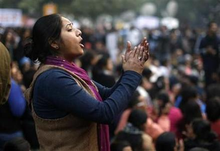 A demonstrator shouts slogans during a protest in New Delhi December 29, REUTERS/Ahmad Masood