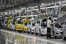 Usine Hyundai à Kancheepuram, dans l'Etat indien du Tamil Nadu. Hyundai Motor et sa filiale Kia Motors, les deux principaux constructeurs automobiles sud-coréens, tablent pour cette année sur une croissance de 4% de leurs ventes mondiales, qui serait la plus faible depuis 2003. /Photo prise le 4 octobre 2012/REUTERS/Babu