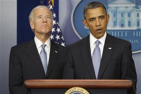 U.S. President Barack Obama delivers remarks next to Vice President Joe Biden (L) after the House of Representatives acted on legislation intended to avoid the ''fiscal cliff,'' at the White House in Washington January 1, 2013. The United States averted economic calamity on Tuesday when lawmakers approved a deal preventing huge tax hikes and spending cuts that would have pushed the world's largest economy off the ''fiscal cliff'' into recession. REUTERS/Jonathan Ernst (UNITED STATES - Tags: POLITICS BUSINESS)