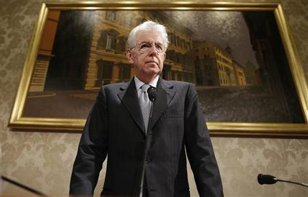 Italy's outgoing Prime Minister Mario Monti looks on during a news conference in Rome December 28, 2012. REUTERS/Tony Gentile
