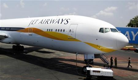 A Jet Airways Boeing 777-300ER aircraft sits on the tarmac at Mumbai airport May 13, 2007. REUTERS/Punit Paranjpe/Files