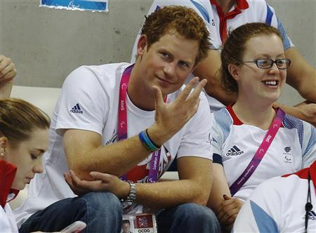 Britain's Prince Harry reacts as he watches the Paralympic swimming heats at the London 2012 Paralympic Games at the Aquatics Centre in the Olympic Park September 4, 2012. REUTERS/Luke MacGregor