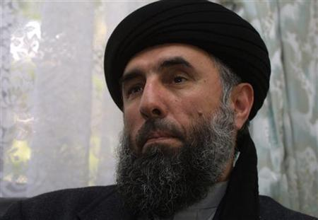 Former Afghan Prime Minister Gulbuddin Hekmatyar speaks to a Reuters correspondent in Tehran Febuary 5, 2002. REUTERS/Caren Firouz/Files