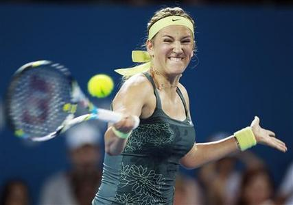 Victoria Azarenka of Belarus hits a return to Sabine Lisicki of Germany during their women's singles match at the Brisbane International tennis tournament January 2, 2013. REUTERS/Daniel Munoz