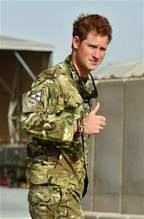 Britain's Prince Harry gestures after passing the Apache helicopter flight line at Camp Bastion, Afghanistan September 7, 2012. REUTER/John Stillwell/POOL