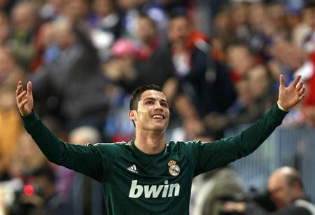 Real Madrid's Cristiano Ronaldo gestures during their Spanish First Division soccer match against Malaga at La Rosaleda stadium in Malaga December 22, 2012. REUTERS/Marcelo del Pozo