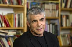 Yair Lapid speaks during an interview with Reuters in Tel Aviv December 31, 2012. REUTER/Baz Ratner