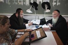 Ultra-Orthodox Jews work in the trading room of Israel's diamond exchange in Ramat Gan near Tel Aviv October 30, 2012. REUTERS/Nir Elias