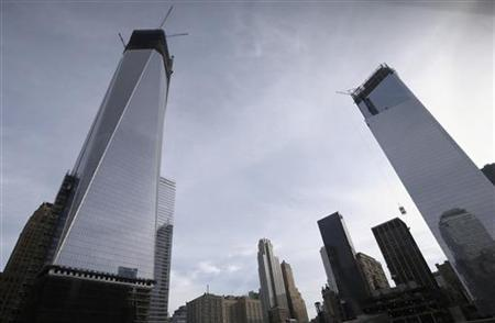 Cranes tower over the World Trade Center site in New York's lower Manhattan, December 12, 2012. REUTERS/Brendan McDermid