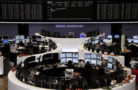 Traders are pictured at their desks in front of the DAX board at the Frankfurt stock exchange January 2, 2013. REUTERS/Remote/Joachim Herrmann
