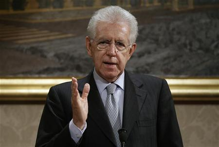 Italy's outgoing Prime Minister Mario Monti gestures during a news conference in Rome December 28, 2012. REUTERS/Tony Gentile