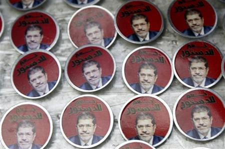 Badges showing an image of Egypt's President Mohamed Mursi and the words ''Yes to constitution'' are displayed at a street stall outside Al Azhar mosque in old Cairo December 28, 2012. REUTERS/Amr Abdallah Dalsh