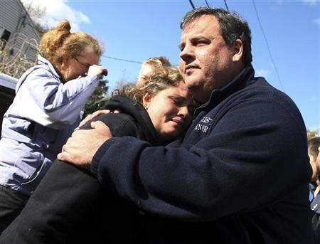 New Jersey Governor Chris Christie comforts Kerri Berean whose home was damaged by Hurricane Sandy in Little Ferry, New Jersey, November 3, 2012 in this handout image courtesy of the governor's office. REUTERS/New Jersey Governor's Office/Tim Larsen/Handout