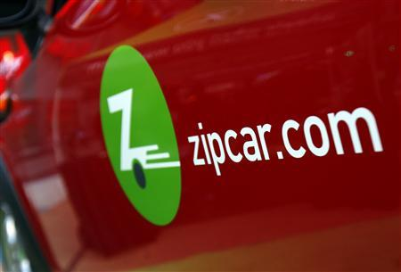 The Zipcar.com logo is seen on a Mini Cooper car during a promotional event in New York's Times Square in this file photo taken April 14, 2011. REUTERS/Mike Segar/Files