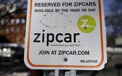 A sign marks a reserves Zipcar parking space in Cambridge, Massachusetts January 2, 2013. Car rental company Avis Budget Group Inc will buy Zipcar Inc for about $500 million in cash to join larger rivals Hertz Global Holdings Inc and Enterprise Holdings Inc in the fast-growing U.S. car-sharing market. REUTERS/Brian Snyder (UNITED STATES - Tags: BUSINESS TRANSPORT)