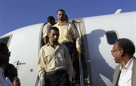 Jordanian peacekeepers Hassan Mizawoda and Haleem Al Sarhaan arrive at Khartoum Airport, January 2, 2013, after 136 days of captivity in Sudan's Darfur region according to local media. REUTERS/Mohamed Nureldin Abdallah