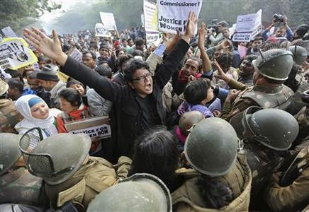 Demonstrators shout slogans as they are surrounded by the police during a protest rally in New Delhi in this December 27, 2012 file photo. Beaten and raped by five men and a teenager on a moving bus in the capital on Dec. 16, a 23-year-old student died from her injuries on Dec. 29 which resulted in thousands of outraged young Indians taking to the streets of New Delhi almost every day protesting for justice and security for women. India's politicians, seen as out of touch with the aspirations of the urban middle class, have been caught off guard by the protests. For the first time, they head into national elections due by May 2014 with women's rights as an issue. Picture taken December 27, 2012. REUTERS/Adnan Abidi/File