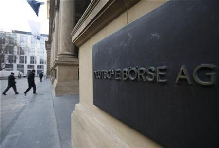 The plaque of the Deutsche Boerse AG is pictured at the entrance of the Frankfurt stock exchange February 1, 2012. European Union regulators have blocked the merger of exchange operators Deutsche Boerse and NYSE Euronext to avoid giving them a stranglehold on the European futures market. Deutsche Boerse and NYSE Euronext, which unveiled the plan to create the world's biggest stock exchange as long ago as February last year, said they would now unwind the deal, the sector's fourth failed tie-up attempt in a year. REUTERS/Alex Domanski (GERMANY - Tags: BUSINESS)