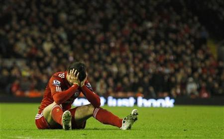 Liverpool's Fernando Torres holds his head in his hands after being fouled during their English Premier League soccer match against Bolton Wanderers at Anfield in Liverpool, northern England, January 1, 2011. REUTERS/Phil Noble
