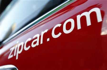 The Zipcar.com logo is seen on a Mini Cooper car during a promotional event in New York's Times Square April 14, 2011. REUTERS/Mike Segar