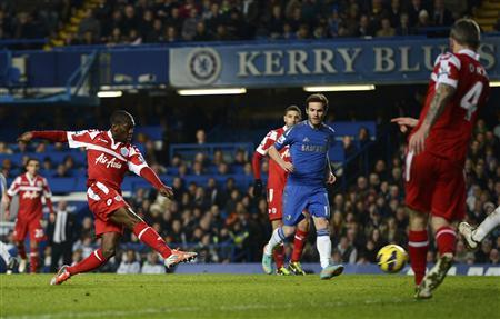 Queens Park Rangers' Shaun Wright-Phillips (L) shoots and scores against Chelsea during their Premier League match at Stamford Bridge in London January 2, 2013. REUTERS/Dylan Martinez