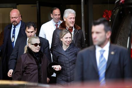 U.S. Secretary of State Hillary Clinton (L) leaves New York Presbyterian Hospital with husband, Bill (TOP), and daughter, Chelsea (C), in New York, January 2, 2013. The secretary of state, who has not been seen in public since Dec. 7, was revealed on Sunday evening to be in a New York hospital under treatment for a blood clot that stemmed from a concussion she suffered in mid-December. REUTERS/Joshua Lott
