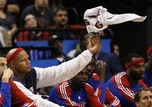 Detroit Pistons forward Charlie Villanueva tosses a towel while sitting on the bench during the second half of their NBA basketball game against the Toronto Raptors in Toronto December 27, 2009. REUTERS/Mike Cassese