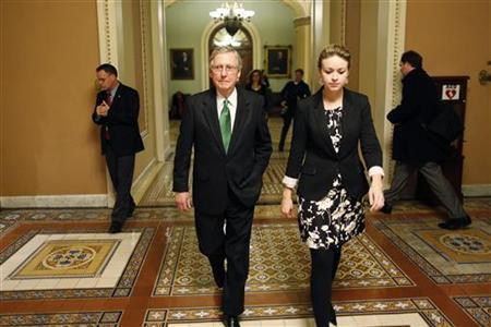 U.S. Senate Minority Leader Mitch McConnell (C) departs the senate floor with an aide after a senate vote in the early morning hours at the U.S. Capitol in Washington January 1, 2013. REUTERS/Jonathan Ernst
