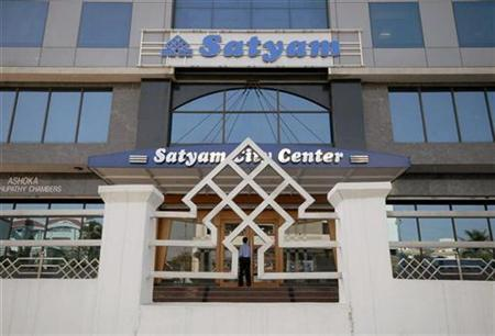 An employee of Satyam Computer Services enters the office building in of Hyderabad January 21, 2009. REUTERS/Krishnendu Halder/Files