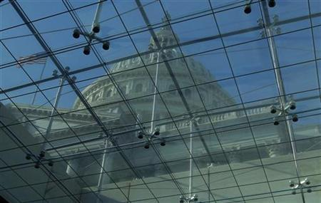 The U.S. Capitol dome is seen through skylights in the Vistor's Center in Washington January 2, 2013. REUTERS/Gary Cameron