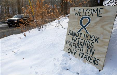 A sign is seen along the route to the Chalk Hill School where the Sandy Hook Elementary School children will attend classes in Monroe, Connecticut, January 2, 2013. REUTERS/Carlo Allegri