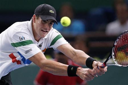 John Isner of the U.S. returns the ball to Michael Llodra of France during the Paris Masters tennis tournament October 31, 2012. REUTERS/Benoit Tessier