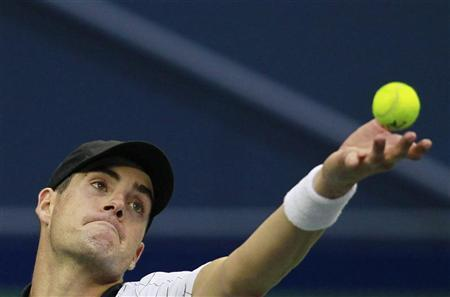 John Isner of the U.S. serves to South Africa's Kevin Anderson during the men's singles match at the Shanghai Masters tennis tournament in Shanghai October 9, 2012. REUTERS/Aly Song