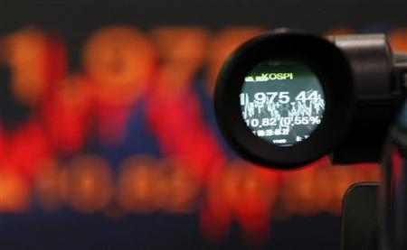 An electronic screen showing the Korea Composite Stock Price Index (KOSPI) is seen through the viewfinder of a TV camera at a dealing room of a bank in Seoul December 12, 2012. REUTERS/Kim Hong-Ji