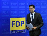 Leader of Germany's liberal Free Democrats FDP and Economy Minister Philipp Roesler leaves after a news conference in Berlin November 5, 2012. REUTERS/Tobias Schwarz (GERMANY - Tags: POLITICS)