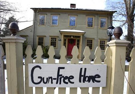 A ''Gun-FreeHome'' sign is seen in front of a house along the route to the Chalk Hill School where the Sandy Hook Elementary School children will begin to attend classes in Monroe, Connecticut, January 2, 2013. The repurposed school is having an open house today and will begin hosting classes tomorrow. REUTERS/Carlo Allegri (UNITED STATES - Tags: CRIME LAW EDUCATION)