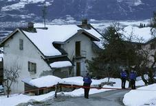 Police stand near a crime scene in the Swiss village of Daillon near Sion January 3, 2013. Three people were killed and two wounded late on Wednesday when a gunman opened fire in the Swiss village of Daillon, Swiss police said on Thursday. REUTERS/Denis Balibouse (SWITZERLAND - Tags: CRIME LAW CIVIL UNREST)