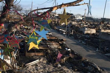 Christmas ornaments sit amongst the remains of homes destroyed by fire during Hurricane Sandy in the Breezy Point area of New York's borough of Queens, December 25, 2012. REUTERS/Keith Bedford (UNITED STATES - Tags: ENVIRONMENT DISASTER SOCIETY)