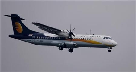 A Jet Airways aircraft prepares to land at the airport in Mumbai September 13, 2009. REUTERS/Punit Paranjpe