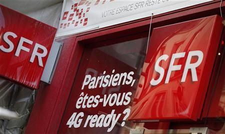 The logo of French mobile phone operator SFR is seen on the facade of a shop in Paris October 15, 2012. REUTERS/Mal Langsdon