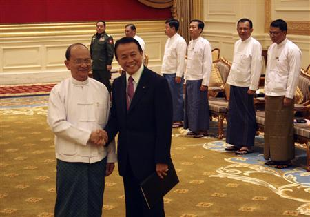 Japan's Deputy Prime Minister and Finance Minister Taro Aso shakes hands with Myanmar's President Thein Sein (L) as they meet in the capital Naypyitaw January 3, 2013. Aso is in Myanmar for talks with Thein Sein to boost relations with the rapidly transforming country and support Japanese business interests in the region. REUTERS/Antoni Slodkowski