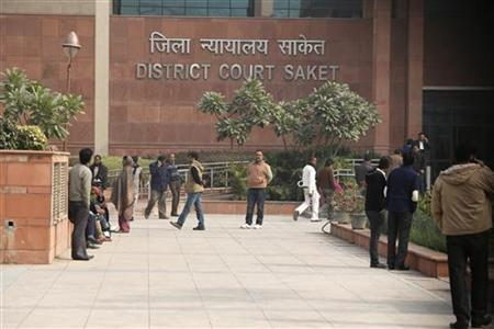 People arrive at a district court in New Delhi January 3, 2013. REUTERS/Adnan Abidi