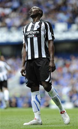 Newcastle's Shola Ameobi reacts following a missed opportunity against Rangers during their friendly match at Ibrox Stadium, Glasgow, Scotland, August 7, 2010. REUTERS/Russell Cheyne