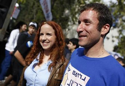 Labour party candidates Itzik Shmuli (R) and Stav Shaffir attend a mock election at a high school in Ramat Gan near Tel Aviv December 6, 2012. REUTERS/Amir Cohen