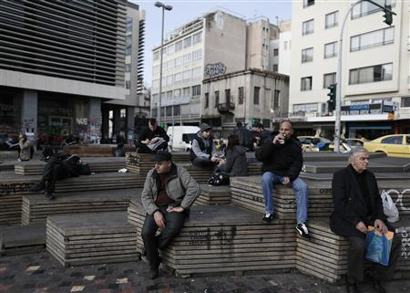 People rest at Monastiraki square in central Athens January 3, 2013. REUTERS/John Kolesidis