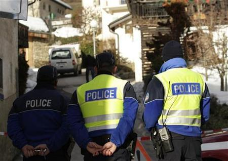 Police stand near a crime scene in the Swiss village of Daillon near Sion January 3, 2013. REUTERS/Denis Balibouse