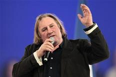 French actor Gerard Depardieu delivers a speech during a campaign rally for France's President Nicolas Sarkozy, candidate for the 2012 French presidential election, in Villepinte, northern Paris March 11, 2012. REUTERS/Charles Platiau (FRANCE - Tags: POLITICS ELECTIONS ENTERTAINMENT)