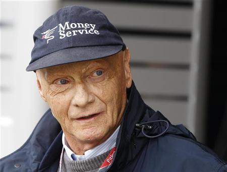 Former Austrian Formula One World Champion Niki Lauda talks to journalists in the paddock prior to the British F1 Grand Prix at Silverstone, central England July 9, 2011. REUTERS/Leonhard Foeger